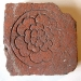 Incised brick floor tile