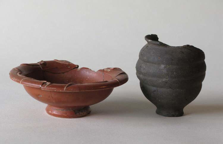 Samian ware bowl and pottery beaker